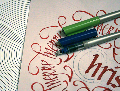 Calligraphy  Christmas card sketch and tools