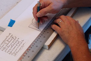 Using the Ames lettering guide to make parallel guidelines easily.